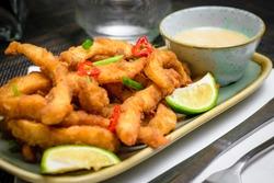fresh healty meal crispy asian seafood snack with lemon
