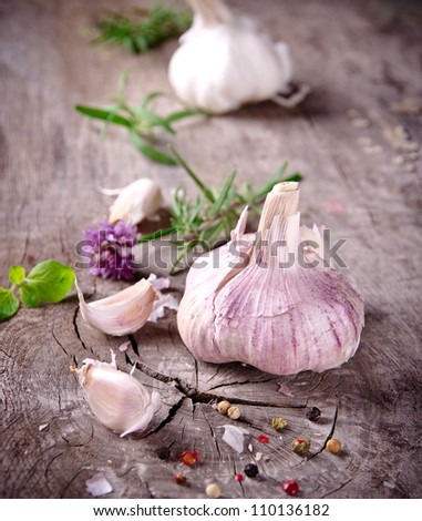 Fresh herbs and spices on wooden background