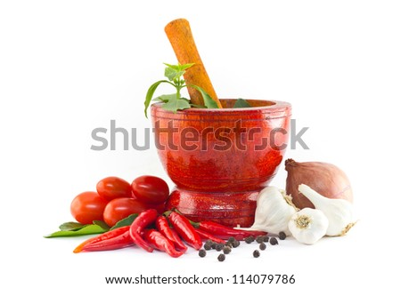 Fresh herbs and spices with wooden mortar isolated  on white background
