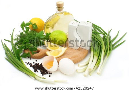 fresh herbs, leek, lemon, lime, oil, spices and eggs isolated on white background