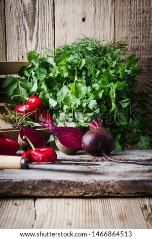 Fresh homegrown beetroots,herbs, hot red peppers, on wooden rustic table, plant based food, local produce, close up. Organic vegetables, healthy  vegan eating, harvest time