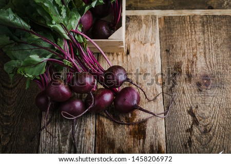 Fresh homegrown beetroots on wooden rustic table,  plant based food, local produce, close up
