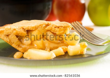fresh homemade apple pie over green glass dish macro colseup eating  with fork