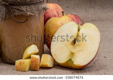 Fresh homemade applesauce on a textile background