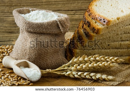 Fresh homemade bread and flour in small burlap bag