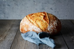 Fresh homemade bread on a gray background. Crisp. French bread. Bread at leaven. Unleavened bread