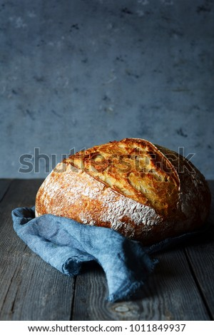 Fresh homemade bread on a gray background. Crisp. French bread.  Bread at leaven. Unleavened bread #1011849937