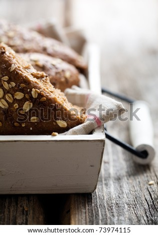Fresh homemade bread on wooden table, selective focus