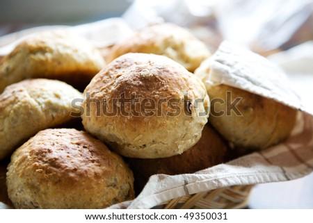 Fresh homemade bread rolls in little basket