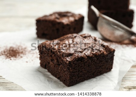 Fresh homemade brownies on table, closeup. Delicious chocolate pie #1414338878