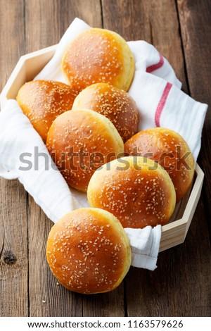 Fresh homemade burger buns with sesame.