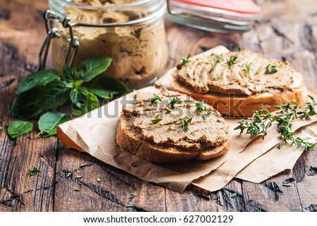 Shutterstock Fresh homemade chicken liver pate on bread over rustic background