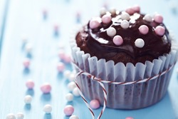 Fresh Homemade Chocolate Cupcakes Decorated with Pink and White Pearls