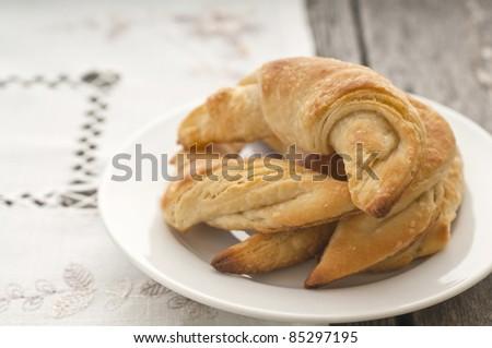 Fresh homemade croissants in white plate