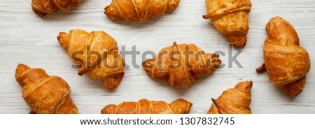 Fresh homemade croissants on white wooden table, top view. From above, overhead. #1307832745
