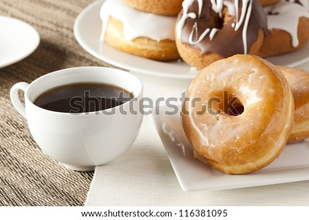 Fresh Homemade Donuts and Coffee against a background