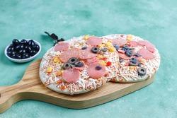 Fresh homemade frozen mini pizzas.
