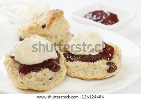 Fresh homemade fruit scones with jam and cream.