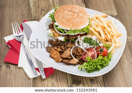 Fresh homemade Kebab Burger with Chips on wooden background
