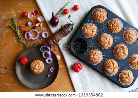 Fresh homemade muffins with cherry tomatoes, onion, garlic and paprika #1319354882