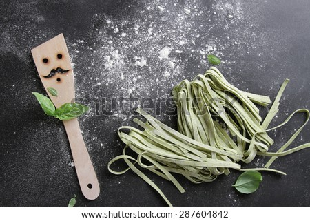 Fresh homemade pasta  with spatula on table, selective focus