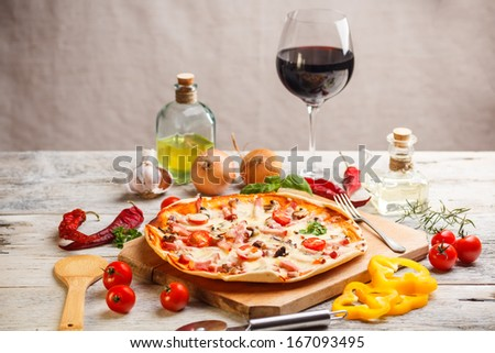Fresh homemade pizza served with red wine