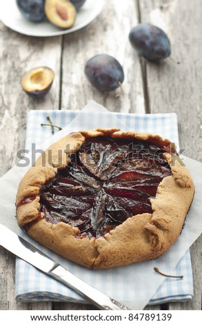 Fresh homemade plum galette over the table