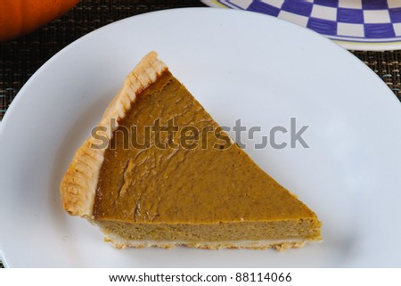 Fresh homemade pumpkin pie on a plate - stock photo