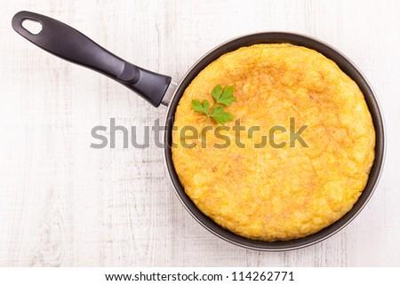 Fresh homemade Spanish tortilla (omelette) in the frying pan