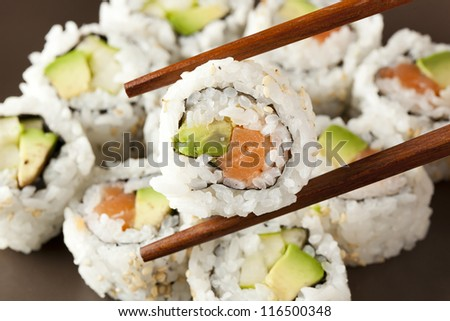 Fresh Homemade Sushi Roll against a background