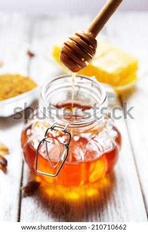 Fresh honey on wooden table - Shutterstock ID 210710662