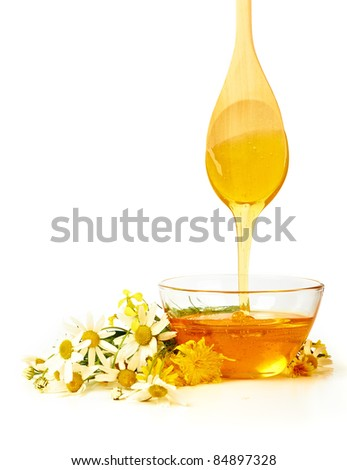 fresh honey with flowers on a white background