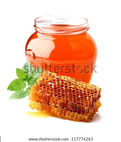 Fresh honey with honeycombs and mint