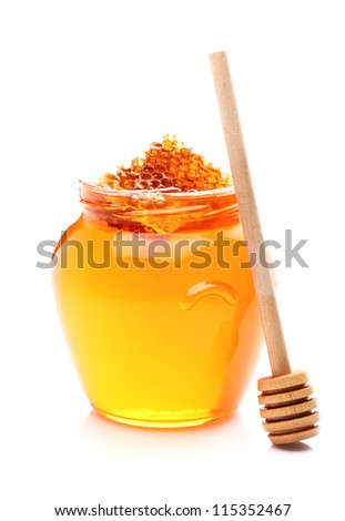 Fresh honey with wooden spoon