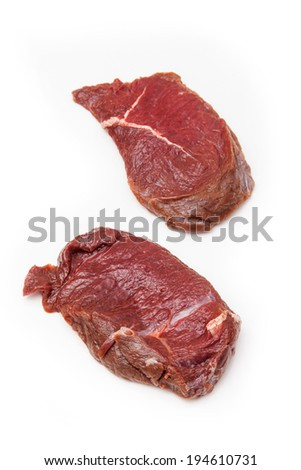Fresh horse meat steak isolated on a white studio background.