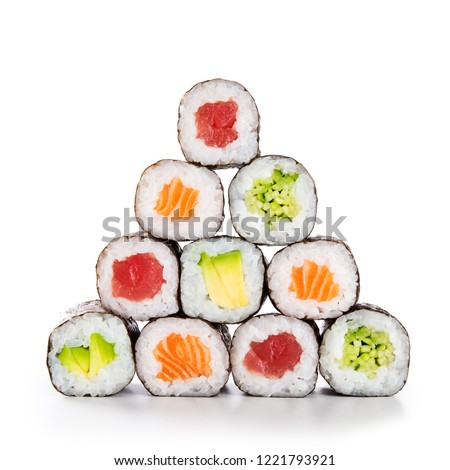 Fresh hosomaki in a pyramid isolated on white background. Sushi roll with salmon, tuna, avocado and cucumber. Traditional japanese food with maki. Delicious sushi pieces. Photo stock ©