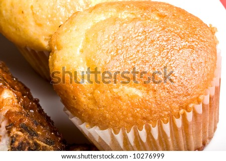 fresh hot homecooked cornbread muffins close up on a white plate