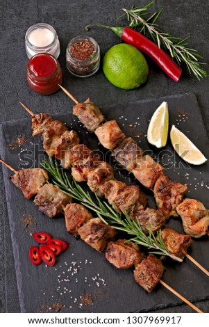 Fresh hot kebab with rosemary, lime and chili. Keto diet. Paleo diet. Pegan diet. #1307969917