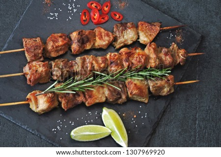 Fresh hot kebab with rosemary, lime and chili. Keto diet. Paleo diet. Pegan diet.