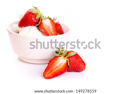 Fresh ice cream in a plate with strawberry isolated on white