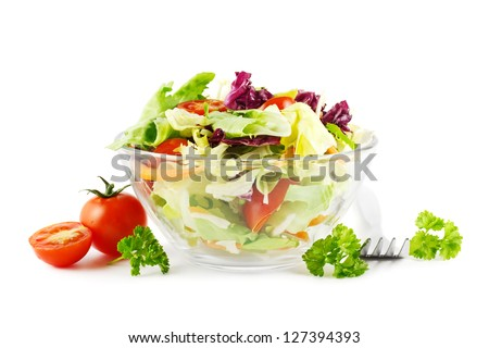 Fresh iceberg lettuce and tomato salad in a glass bowl on white - stock photo