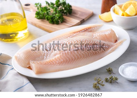 Fresh Icelandic Haddock Fillets on a plate with lemon and parsley. ストックフォト ©