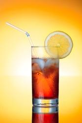 Fresh icetea drink with lemon. HQ studio shot.