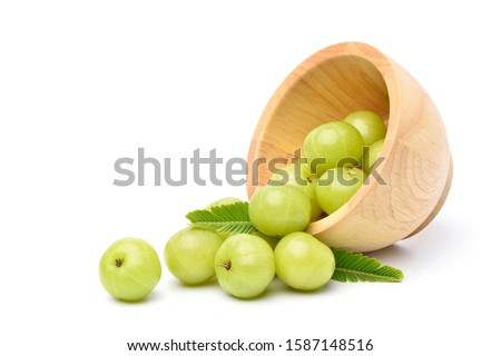 Fresh Indian gooseberry fruits in wooden  bowl  with green leaves on white background. Stock photo ©