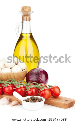 Fresh ingredients for cooking: tomato, mushroom and spices. Isolated on white background - stock photo