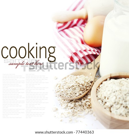 Fresh ingredients for oatmeal cookies (oat flakes, eggs, milk) over white with sample text
