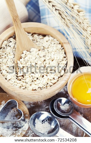 Fresh ingredients for oatmeal cookies (oat flakes, eggs, salt, flour)