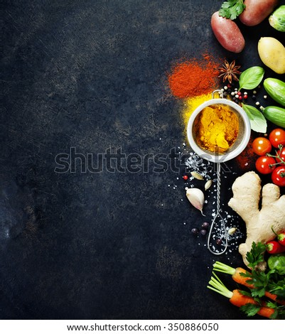 Fresh  ingredients on dark background. Vegetarian food, health or cooking concept. Background layout with free text space.