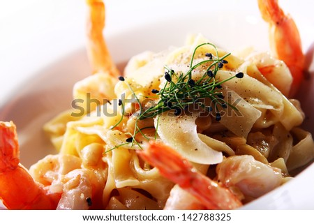 Fresh italian seafood pasta served with shrimps - stock photo