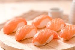 Fresh japanese salmon sushi on wood table